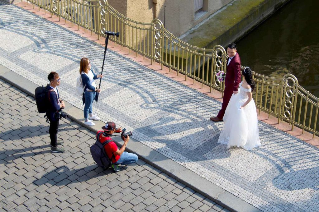 Wedding photographer and his team taking prenup photos with the couple